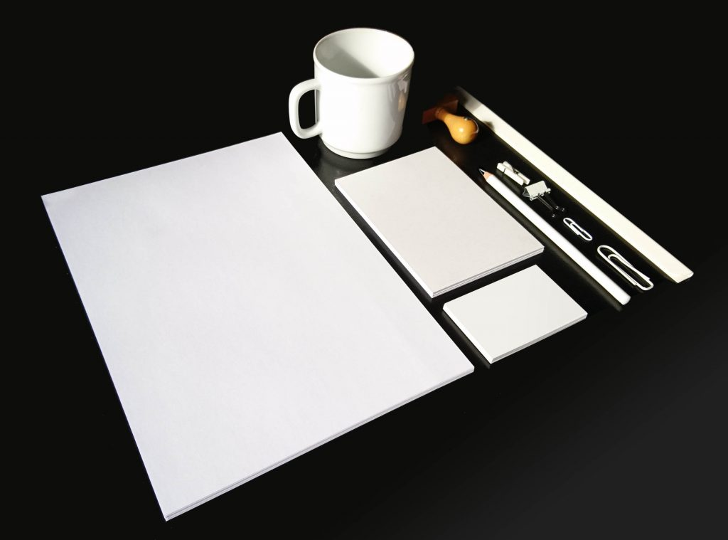 A collection of office material that usually is needed for corporate design: Letterpaper, letterhead, business cards, pencils, pape bloc, cup, stamp, clips