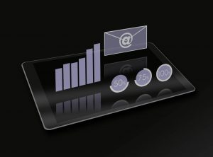 Digital Marketing: Above a tablet computer hovering transparent symbols, representing webdesign, website, content management system, CMS, intranet, extranet, newslettersystems, webpages, online shop, programming, online, E-Mail- and search engine marketing